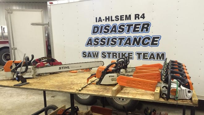 Saws of varying sizes sit in front of a trailer for the Iowa Homeland Security and Emergency Management Division's Saw Strike Team.