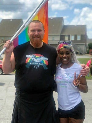 Jacksonville Pride Festival founder Kimberly Mitchell, right, was joined in this 2019 photo by festival-goer Giovonni Addams, holding a rainbow flag.