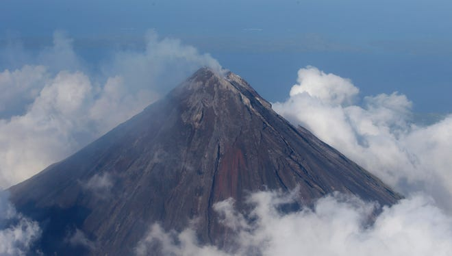 Smoke billows from the crater of Mayon volcano, one of the country's most active volcanoes, in Albay province about 550 kilometers southeast of Manila, Philippines.