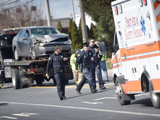 """One official responding to a collision between a garbage truck and an automobile called the scene """"chaotic."""" Three children were transported to Hershey Medical Center after first responders responded to an accident at 12:03 p.m. Monday, March 21, just west of the intersection of 12th and Cumberland Streets. Both east and west bound lanes were shut down for a short while while debris were cleared from the roadway."""