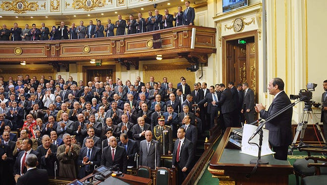 Egyptian President Abdel-Fattah el-Sissi, right, addresses parliament in Cairo on Feb. 13, 2016.
