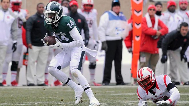 MSU's Tony Lippett grabs a pass for an eventual touchdown against Rutgers in East Lansing Saturday 11/22/2014.