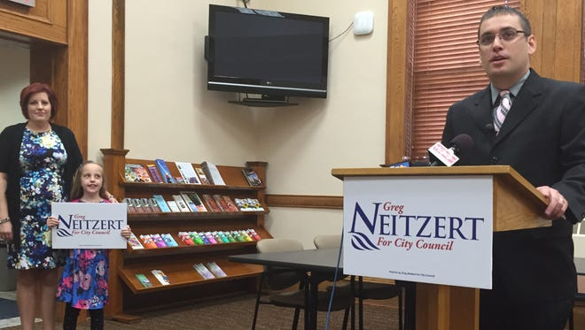 Greg Neitzert, joined by wife Jennifer and daughter Olivia, announced his candidacy for Sioux Falls City Council Tuesday at Carnegie Town Hall.