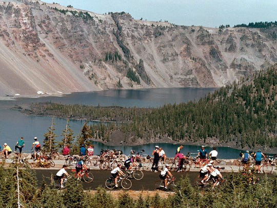 Cyclists ride along Crater Lake in southwest Oregon.