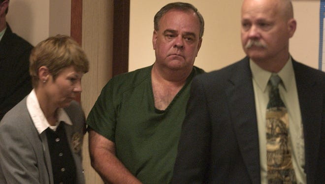 Gerald Carnahan is led into the courtroom for his arraignment in the 1985 murder of Jackie Johns.