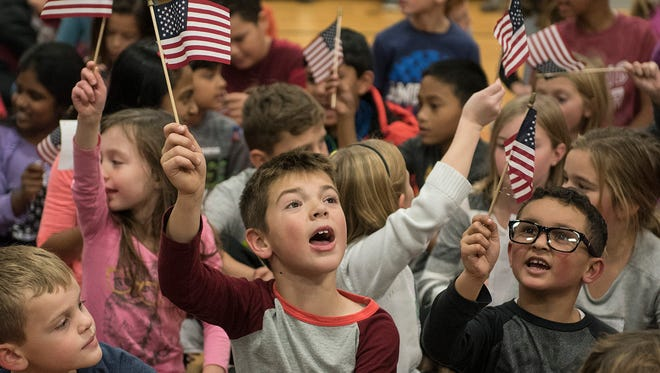 The students are ready to honor the veterans.