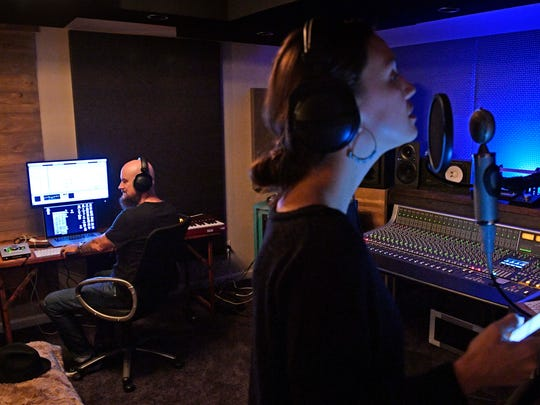 "Lauren ""Whissell"" Whistle lays down a track as  Hip hop producer and songwriter Jim Jonsin mans the controls in his studio in Brentwood, Tenn., Wednesday Nov. 15, 2017."