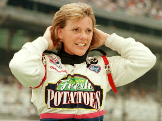 Driver Lyn St. James shown in 1999 after pole day.