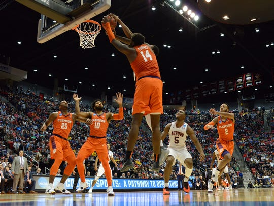 Clemson Tigers forward Elijah Thomas reaches for a rebound.