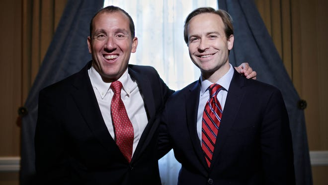 Democrat Supreme Court Justice Richard Bernstein, right, and Republican Lt. Governor Brian Calley are photographed at the Dearborn Inn in October 2015 in Dearborn.