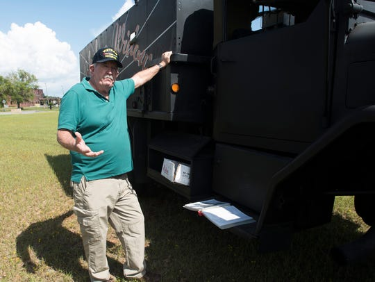 Vietnam Army veteran Ron Smith shows off a replica