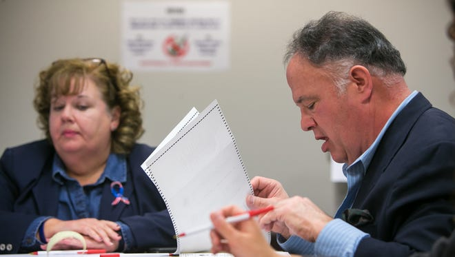 Election officials recounted absentee ballots by hand on Tuesday after Ben Cohen requested a recount. Cohen along with Ciro Adams (right) and their legal associates recounted themselves to confirm the absentee ballots.