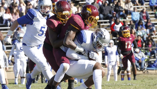 Pearl River defenders wrap up the Co-Lin ball carrier during the Wildcats' 40-21 victory Saturday in Wesson.