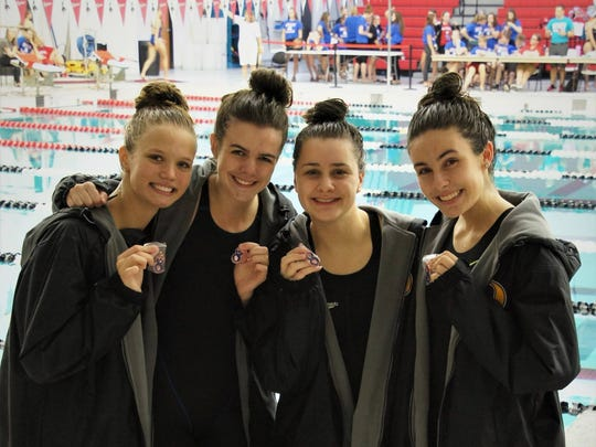 Members of the Oconomowoc 200-yard freestyle relay team pose after taking third place at the Classic 8 Conference swimming and diving meet. They include (from left), Amanda Jordan, Dani Rabay, Shaelyn Rutta and Payton Sheridan.