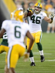 Green Bay Packers tight end Colt Lyerla prepares to hurdle a defender during Family Night at Lambeau Field on Saturday