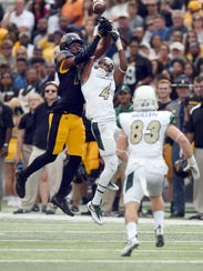 Southern Miss defensive back Tarvarius Moore blocks a play during a game against Charlotte at M.M. Roberts Stadium.
