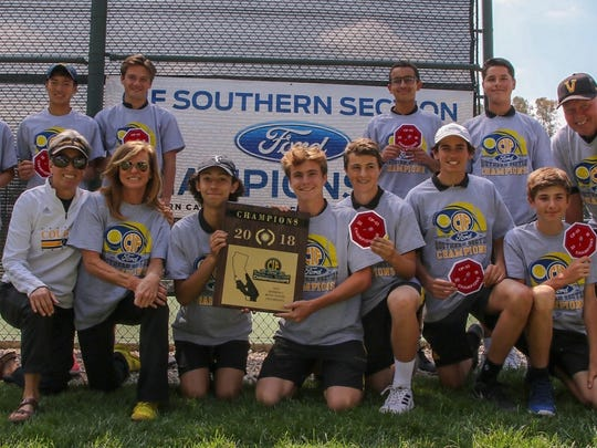 The Ventura High boys tennis team poses with its championship plaque and patches after being Troy 14-4 in the Division 3 final at the Claremont Club.