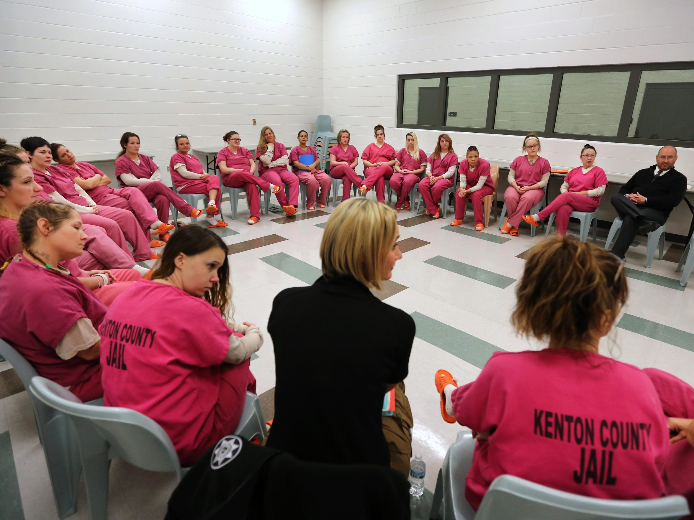 Dominique participates in a group session in a treatment