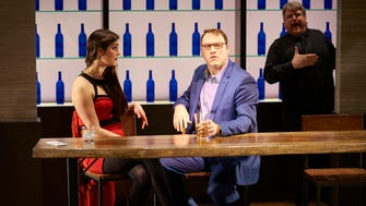 "Sarah Hoch and Michael Gerard Carr star in the regional premiere of the musical ""First Date"" at Ensemble Theatre Cincinnati. In the background is Jared D. Doren, playing a helpful waiter in this scene."