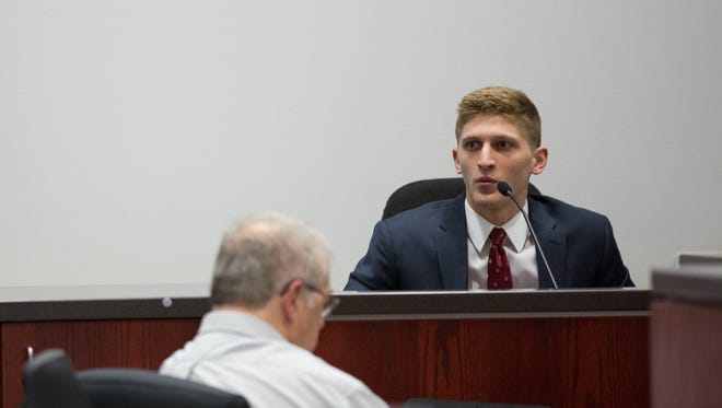 Nick Prato speaks in a courtroom at the Coconino County Superior Court April 19. Prato was shot in the neck.