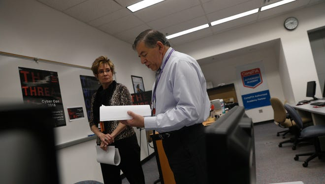 Kathi Hail, a workforce development specialist with the Center for Workforce Development, and San Juan College Center for Workforce Development Director Lorenzo Reyes talk Thursday about the upcoming CyberCon at the San Juan College Quality Center for Business in Farmington.