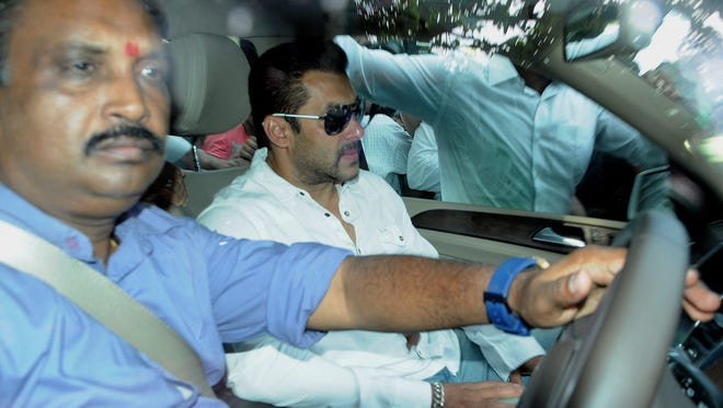 Indian Bollywood star Salman Khan, center,  arrives at the court in Mumbai to be sentenced to five years in prison in connection with a 2002 hit-and-run case.