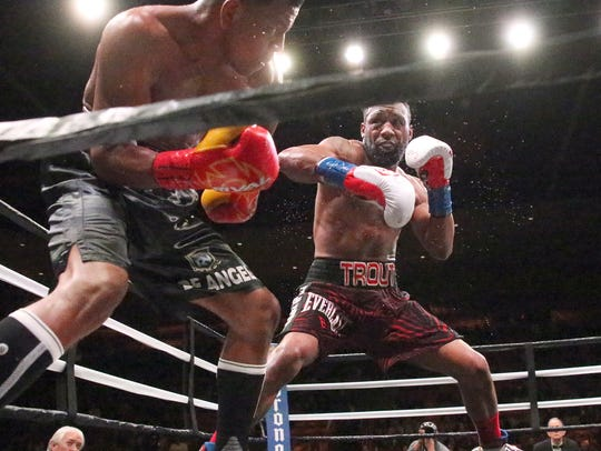 Las Cruces boxer Austin Trout, right, follows Juan