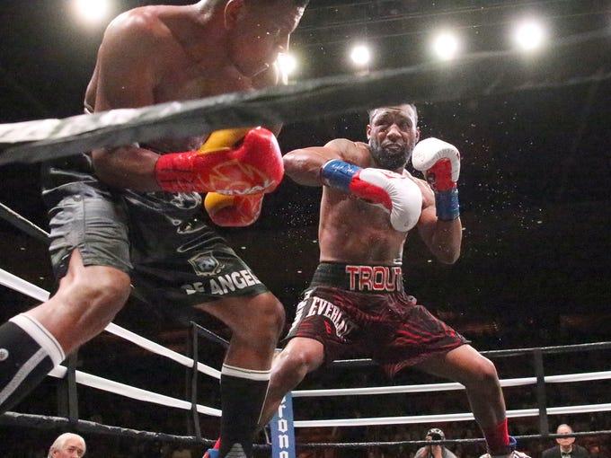 Las Cruces boxer Austin Trout, right, follows Juan