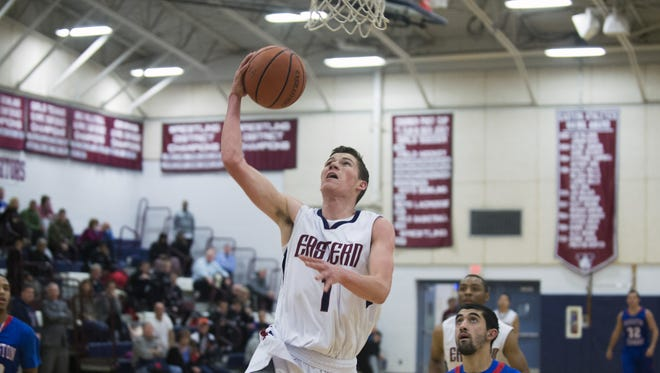 Eastern High School junior Jesse Barbera goes up for two of his career-high 30 points in Thursday's Olympic American game against Washington Township.