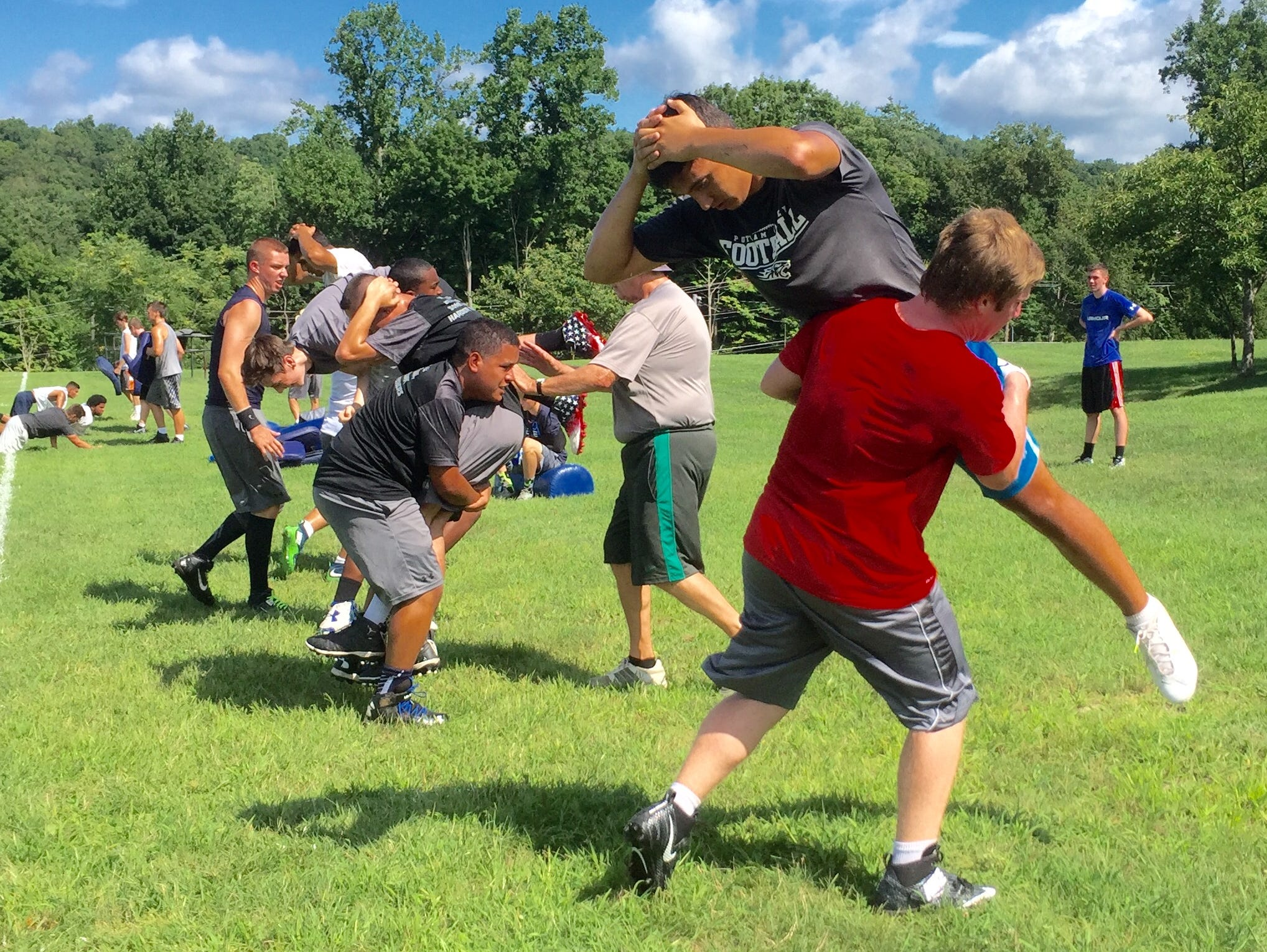 Putnam Valley football players work on drill during the first day of practice.