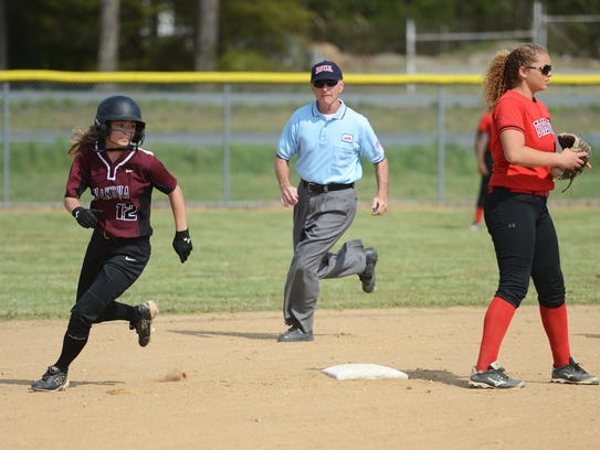 Nandua's Sarah Gepes rounds second base after a steal