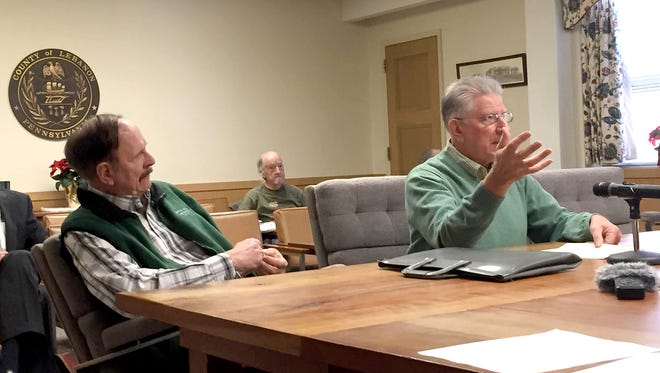 Ray Bender, left, listens as fellow Governor Dick park board member Chuck Allwein updates the Lebanon County commissioners on Thursday about a planned project to build a wheelchair accessible ramp at the 1,100-acre park in West Cornwall Township.