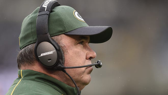 Green Bay Packers coach Mike McCarthy looks on during a game against the Oakland Raiders.