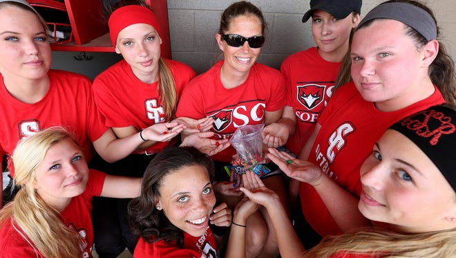 Stewarts Creek softball coach Tory Atwood, middle, began giving out jelly beans to her team to reward them for different achievements. In the front, from left, are Alexandria Decker, Shianne Davis and Morgan Smith. In the back, from left, are Sidney Baker, Carrie Altizer, Atwood, Ciera Dobbins and Loryn Sherwood.