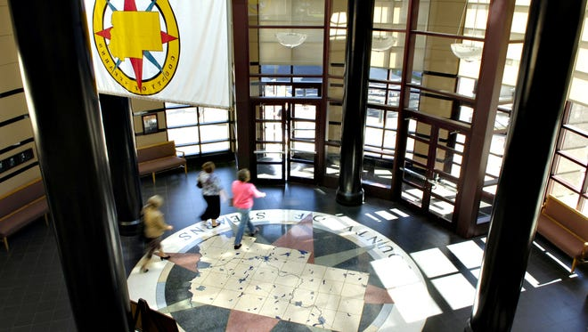 People and staff circulate through the rotunda of the Stearns County Administration Center.