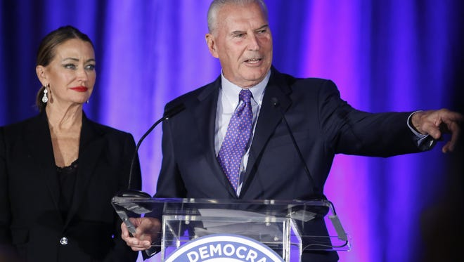 Wilmington mayor-elect Mike Purzycki delivers a victory speech at the Democratic gathering flanked by his wife, Bette, at the DoubleTree Hotel in Wilmington in November.
