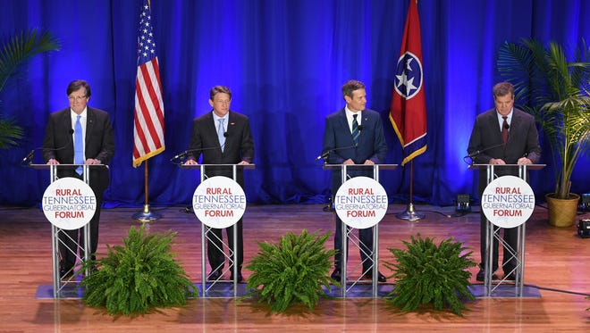 Craig Fitzhugh, Randy Boyd, Bill Lee, and Karl Dean stand on stage in preparation for the Rural Tennessee Gubernatorial Forum, Tuesday, April 17, at Lane College in Jackson, Tenn.
