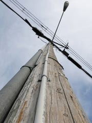 A half-inch PVC pipe marks the eruv on Airmont Avenue in Mahwah.