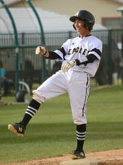 Abilene High's Marcus Romero reacts after hitting a