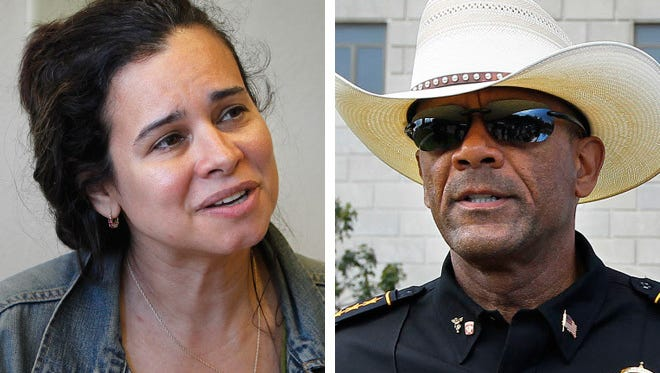 Christine Neumann-Ortiz  (left), director of  Voces de la Frontera, criticized Milwaukee County Sheriff David A. Clarke Jr. for his plan to participate in a federal program to identify illegal immigrants.