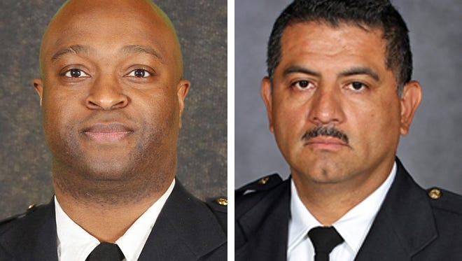 Inspector Michael Brunson (left) and Capt. Alfonso Morales