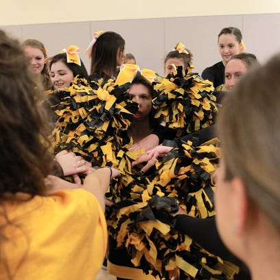 Members of the Hawkeye Sparkles team gather up at the