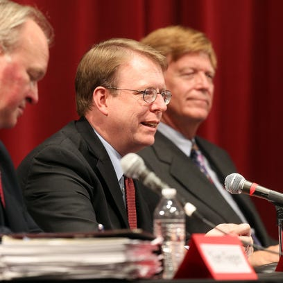Rob Hogg speaks to guests during a debate for the Iowa