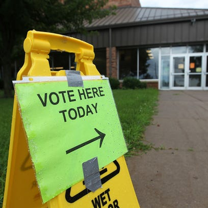 A sign welcomes voters to West High on Tuesday, July