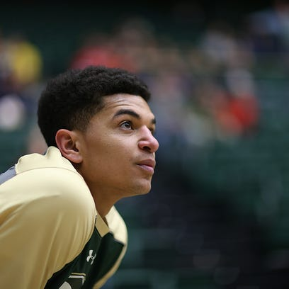 CSU guard Anthony Bonner pauses to watch his teammates