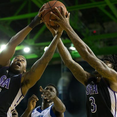 Stephen F. Austin's Leon Gilmore And Ty Charles jump