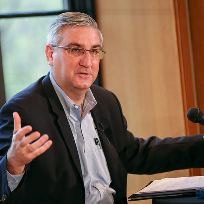 Indiana Gov. Eric Holcomb speaks during press availability