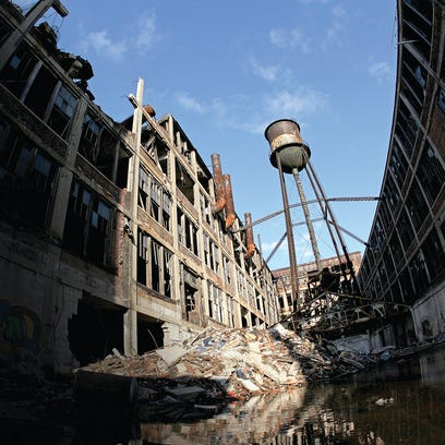 The Packard Plant's south water tower stands above