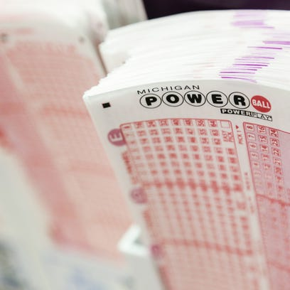 Slips for the Michigan Powerball sit on the counter