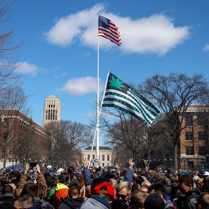 Hash Bash attendees celebrates as the national anthem